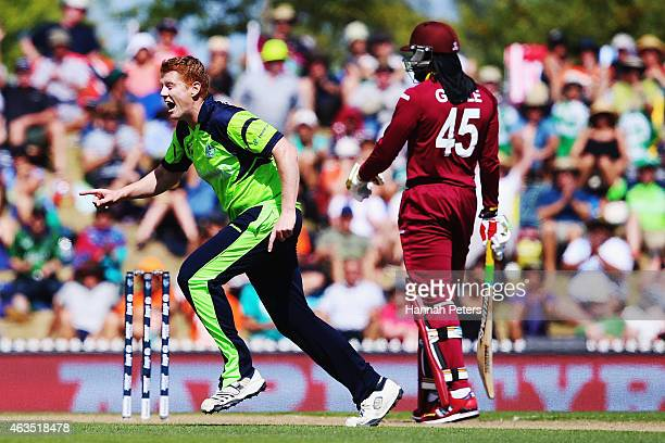 Kevin O'Brien of Ireland celebrates the wicket of Darren Bravo of West Indies during the 2015 ICC Cricket World Cup match between the West Indies and...
