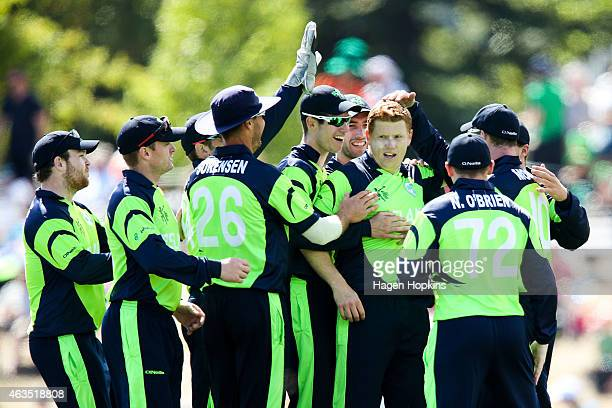 Kevin O'Brien of Ireland celebrates with teammates after taking the wicket of Dwayne Smith of the West Indies during the 2015 ICC Cricket World Cup...