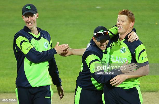Kevin O'Brien of Ireland is congratulated by team mates after getting the wicket of Sean Williams of Zimbabwe during the 2015 ICC Cricket World Cup...