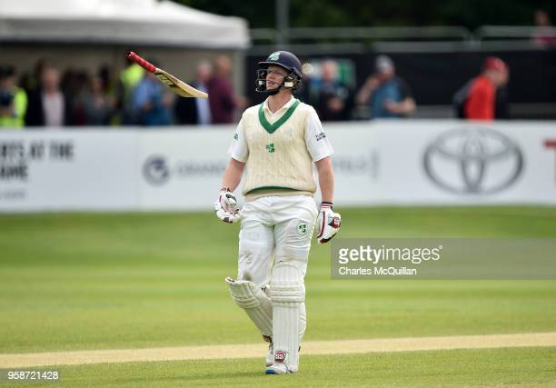 Kevin O'Brien of Ireland throws his bat into the air in disgust after losing his wicket on his opening ball during the fifth day of the international...