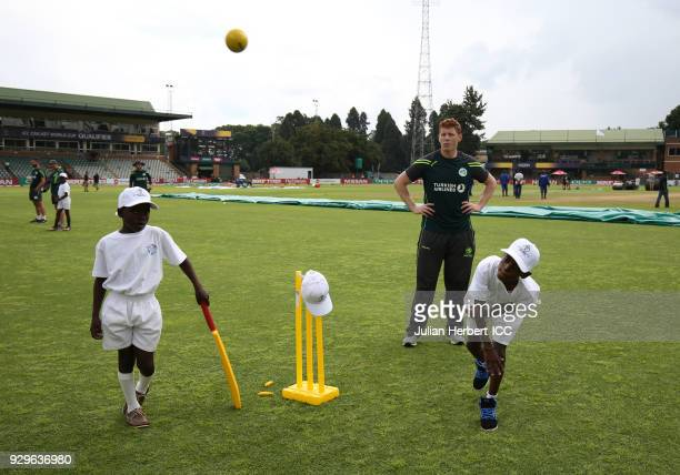 Kevin O'Brien of The Ireland Cricket Team takes part in a Cricket For Good session during The Cricket World Cup Qualifiers at The Harare Sports Club...