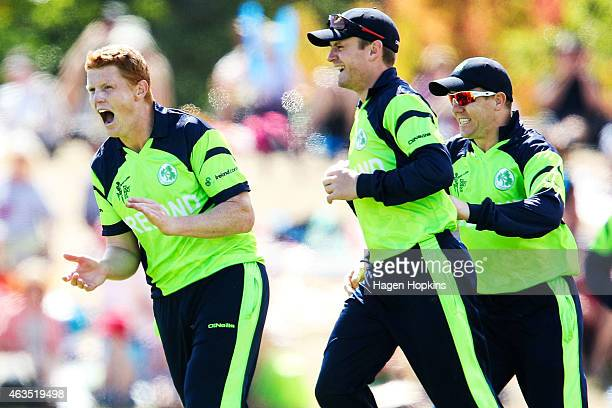 Kevin O'Brien William Porterfield and Niall O'Brien of Ireland celebrate the wicket of Darren Bravo of the West Indies during the 2015 ICC Cricket...