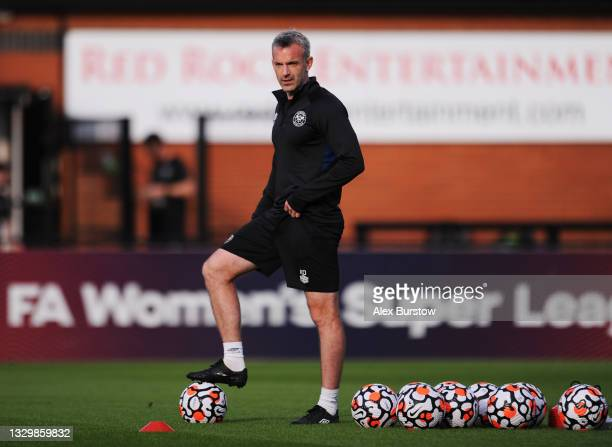 Kevin O'Connor, Assistant First Team Coach of Brentford looks on as players warm up prior to the Pre-Season Friendly match between Boreham Wood and...