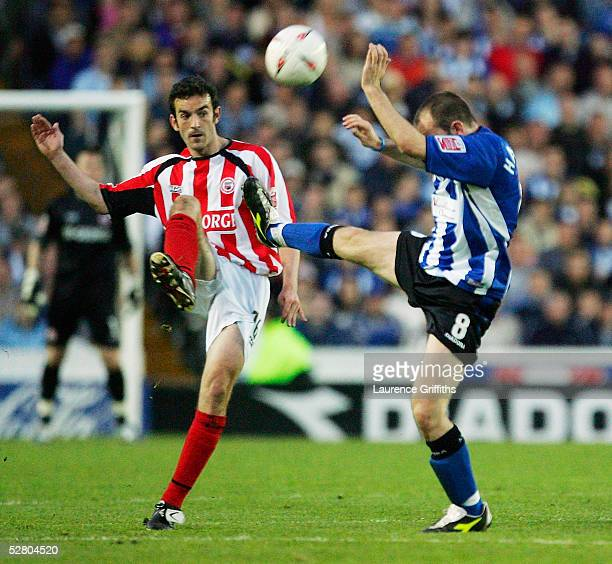 Kevin O'Connor of Brentford battles for the ball with Matt Hamshaw of Sheffield Wednesday during the Coca-Cola Football League Division One Play-Off,...