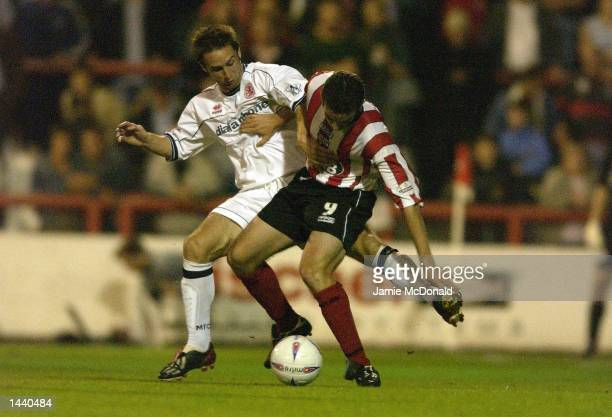 Kevin O'Connor of Brentford battles with Mark Wilson of Middlesbrough during the Worthington Cup Second Round match between Brentford and...