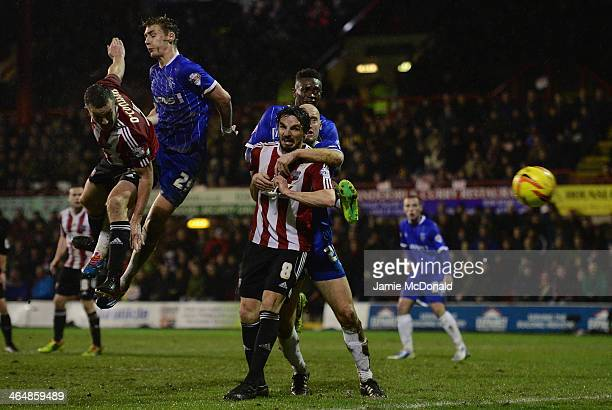 Kevin O'Connor of Brentford heads for goal during the Sky Bet League One match between Brentford and Gillingham at Griffin Park on January 24, 2014...