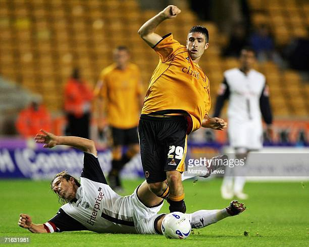 Kevin O'Connor of Wolverhampton Wanderers beats the challenge from Paul McKenna of Preston during the CocaCola Championship match between...
