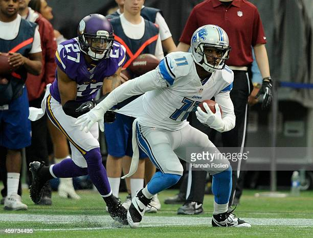 Kevin Ogletree of the Detroit Lions carries the ball against Shaun Prater of the Minnesota Vikings during the third quarter of the game on December...