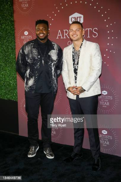 Kevin Olusola and Kane Brown attend the 2021 CMT Artist Of The Year on October 13, 2021 in Nashville, Tennessee.