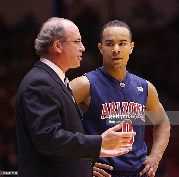 Kevin O'Neill head coach of the Arizona Wildcats gives some instructions to his freshman guard Jerryd Bayless at Hofheinz Pavilion on January 12 2008...