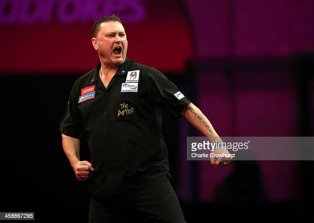 Kevin Painter of England celebrates winning a set during his second round match against Paul Nicholson of England during the Ladbrokescom World Darts...