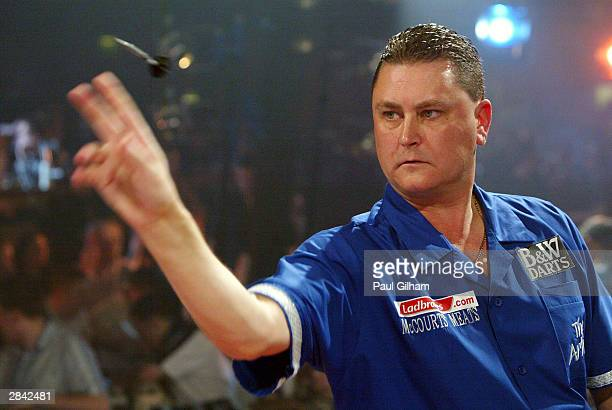 Kevin Painter of England in action against Bob Anderson of England during the Semi Finals of the 2004 Ladbrokes.com World Darts Championship at...