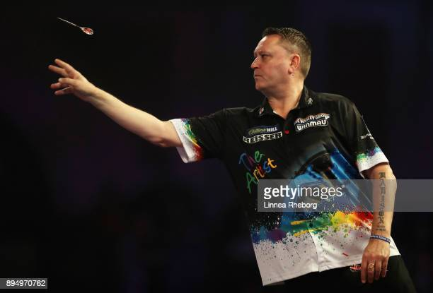 Kevin Painter of England in action during his first round match against Mensur Suljovic of Austria on day five of the 2018 William Hill PDC World...