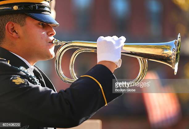 Kevin Palencia with the Mass Army National Guard plays the taps during a Veterans Day Commemoration Ceremony for the 54th Massachusetts Volunteer...