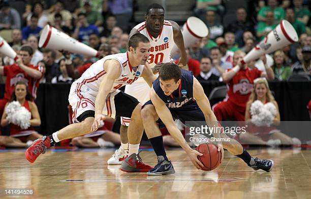 Kevin Pangos of the Gonzaga Bulldogs looks to control the ball in the first half against Aaron Craft and Evan Ravenel of the Ohio State Buckeyes...