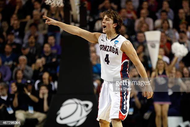 Kevin Pangos of the Gonzaga Bulldogs points on court in the first half of the game against the Iowa Hawkeyes during the third round of the 2015 NCAA...