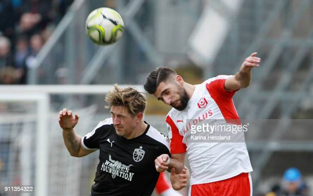 Kevin Pannewitz of Jena and Hilal ElHelwe of Halle jump for a header during the 3Liga match between FC Carl Zeiss Jena and Hallescher FC at Ernst...