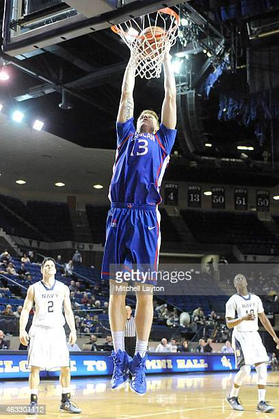 Kevin Panzer of the American University Eagles goes for a dunk during a college basketball game against the Navy Midshipmen at Alumni Hall on January...