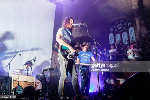 Kevin Parker, Jay Watson and Julien Barbagallo of Tame Impala perform on stage at Albert Hall on July 12, 2014 in Manchester, United Kingdom.