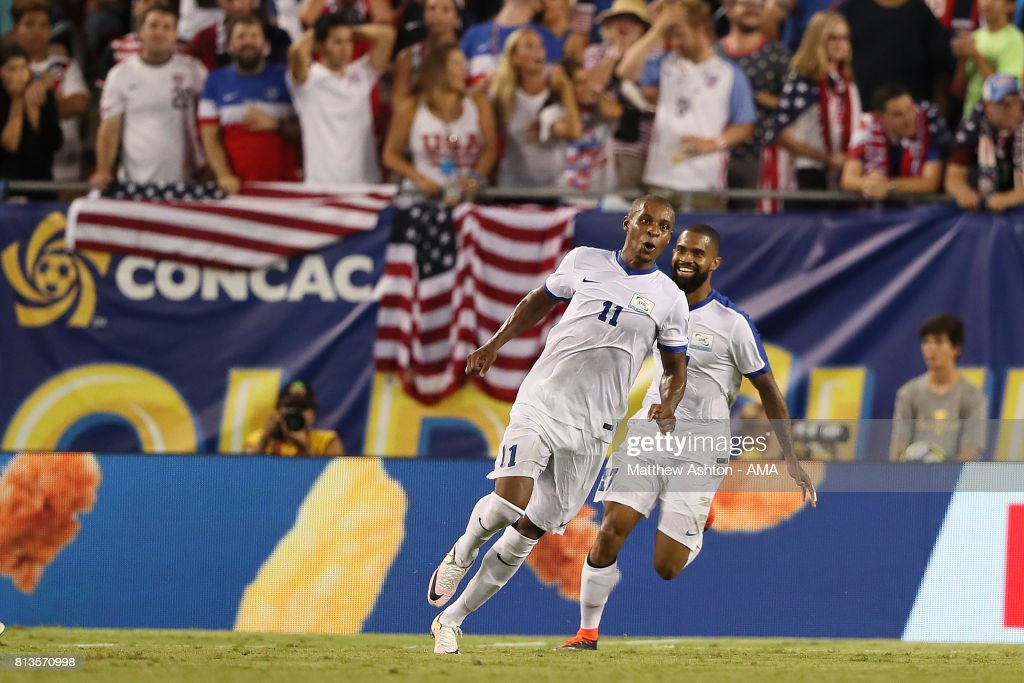 Kevin Parsemain of Martinique celebrates scoring a goal to make the score 2-2 with Johan Audel during the 2017 CONCACAF Gold Cup Group B match between the United States and Martinique at Raymond James Stadium on July 12, 2017 in Tampa, Florida.