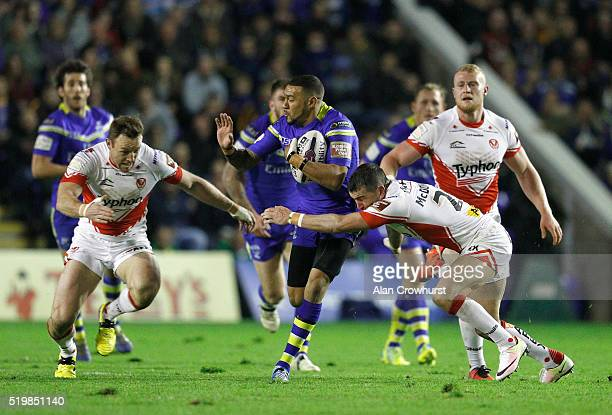 Kevin Penny breaks through a gap fro Warrington during the First Utility Super League match between Warrington Wolves and St Helens at Halliwell...