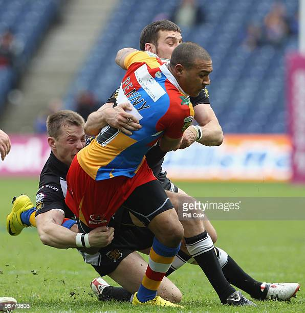 Kevin Penny of Harlequins gets brought down by Craig Hall and Richard Horne of Hull FC during the Engage Rugby Super League Magic Weekend match...