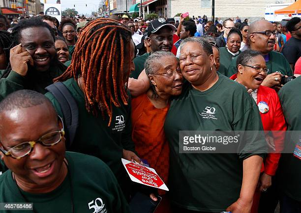 Kevin Peterson left of the New Democracy Coalition and UMass student Vonds Dubuisson second from left smile as Gloria Patterson center of Detroit MI...
