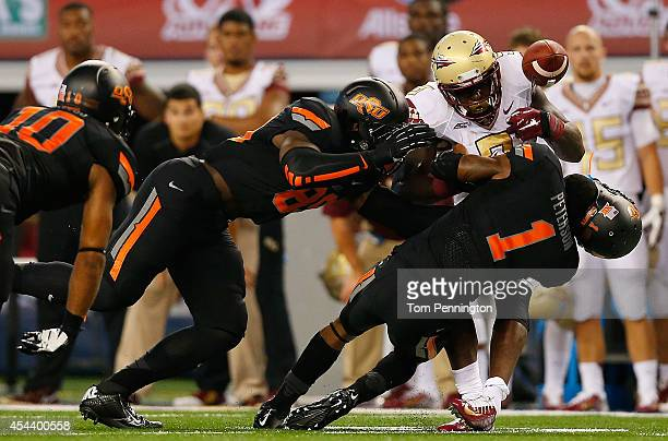 Kevin Peterson of the Oklahoma State Cowboys and Sam Wren of the Oklahoma State Cowboys break up the pass intended for Karlos Williams of the Florida...