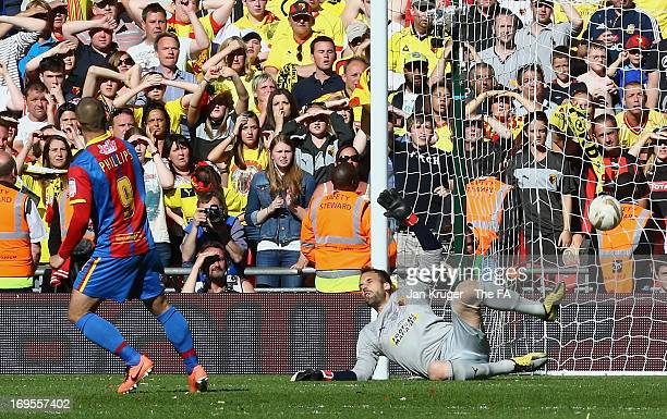 Kevin Phillips of Crystal Palace scores from the penalty spot in extra-time past the dive of Manuel Almunia of Watford during the npower Championship...