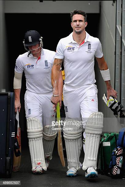 Kevin Pietersen and Ben Stokes of England walk out to bat during day three of the Fourth Ashes Test Match between Australia and England at Melbourne...