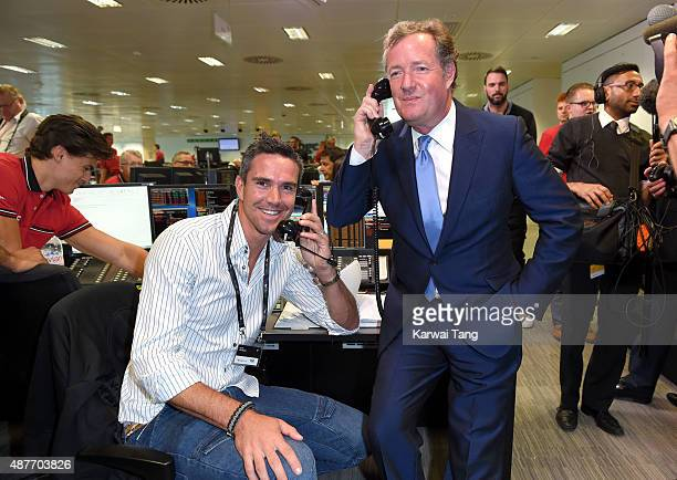 Kevin Pietersen and Piers Morgan attend the annual BGC Global Charity Day at BGC Partners on September 11 2015 in London England