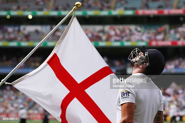 Kevin Pietersen looks up next to the England flag as he walks out to the ground during day two of the Fourth Ashes Test Match between Australia and...