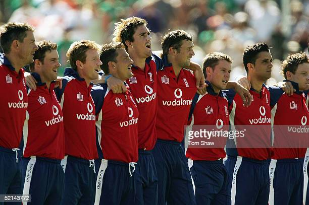 Kevin Pietersen of England and the rest of the England team sing the national anthem during the South Africa v England 4th One Day International...