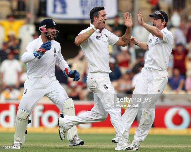 Kevin Pietersen of England celebrates capturing the wicket of Michael Clarke with his Matt Prior and Paul Collingwood during day four of the Second...