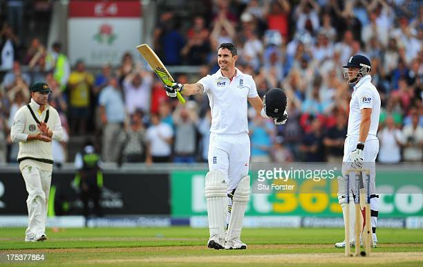 Kevin Pietersen of England celebrates his century as David Warner of Australia and team mate Jonny Bairstow look on during day three of the 3rd...