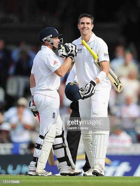 Kevin Pietersen of England celebrates his century with Ian Bell during day two of the 4th npower Test Match between England and India at The Kia Oval...