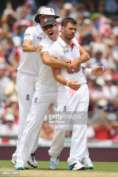 Kevin Pietersen of England congratulates James Anderson of England after he took the wicket of Shane Watson of Australia during day one of the Fifth...