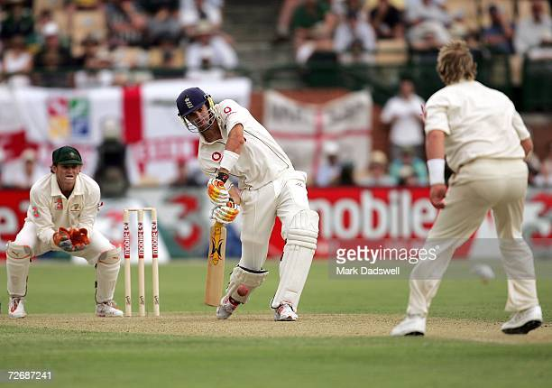 Kevin Pietersen of England drives a delivery from Shane Warne of Australia during day one of the second Ashes Test Match between Australia and...