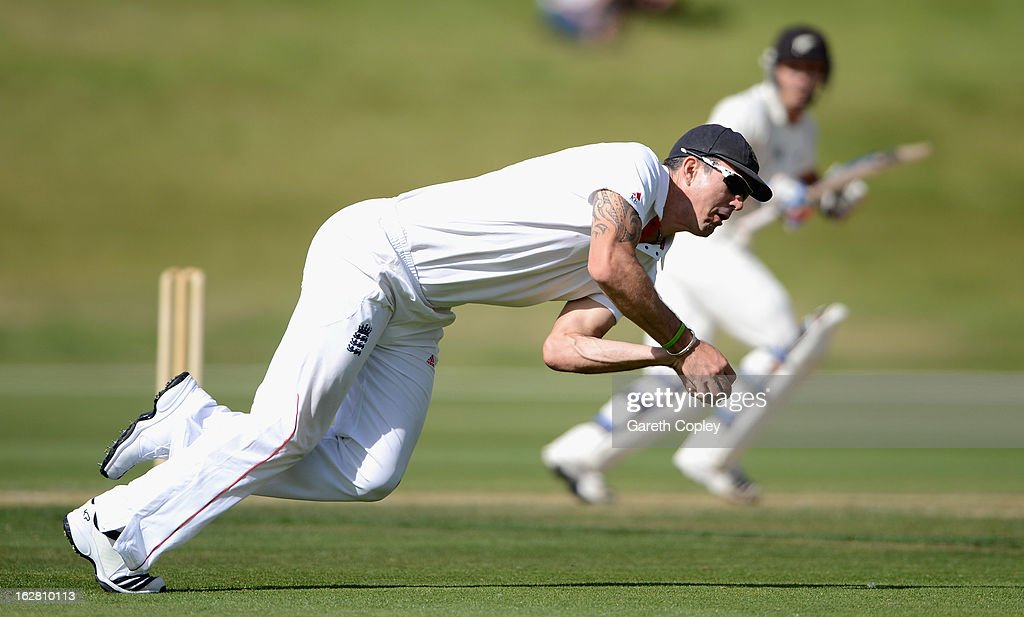 Kevin Pietersen of England fields a ball hit by BJ Watling of a New Zealand during day two of the International tour match between the New Zealand XI and England at Queenstown Events Centre on February 28, 2013 in Queenstown, New Zealand.