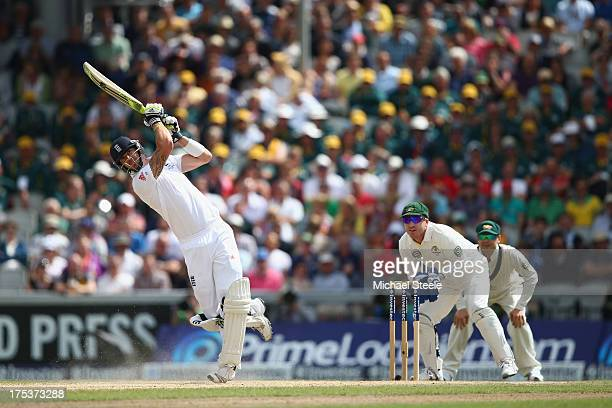 Kevin Pietersen of England hits a six off the bowling of Nathan Lyon as Brad Haddin the wicketkeeper of Australia looks on during day three of the...