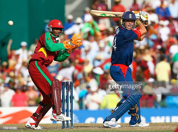 Kevin Pietersen of England hits out watched by Denesh Ramdin of West Indies during the ICC Cricket World Cup Super Eights match between West Indies...