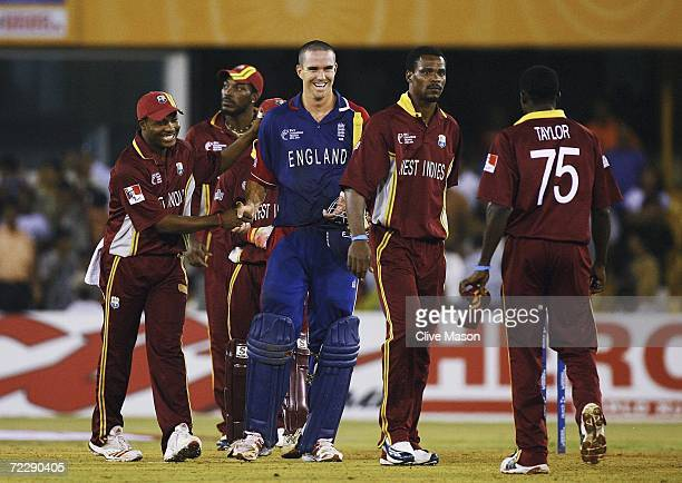 Kevin Pietersen of England is congratulated by Brian Lara of West Indies after the ICC Champions Trophy match between England and the West Indies at...