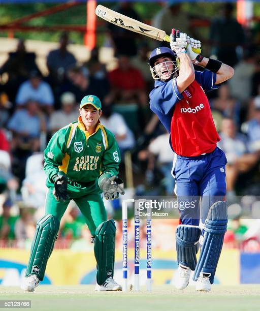 Kevin Pietersen of England on his way to a century watched by Mark Boucher of South Africa during the second one day international match between...