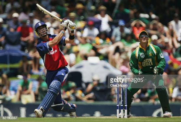 Kevin Pietersen of England on his way to a century watched by Mark Boucher of South Africa during the seventh and final one day international match...