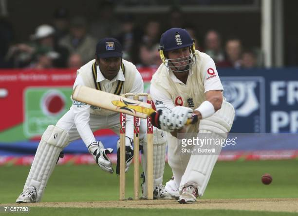 Kevin Pietersen of England plays a shot as Kumar Sangakkara the Sri Lankan wicketkeeper looks on during the second day of the npower second Test...