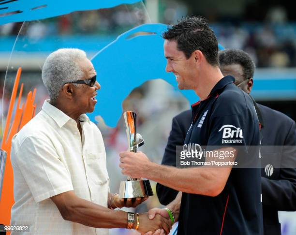 Kevin Pietersen of England receives the Player of the Tournament award from Sir Garfield Sobers following the final of the ICC World Twenty20 between...
