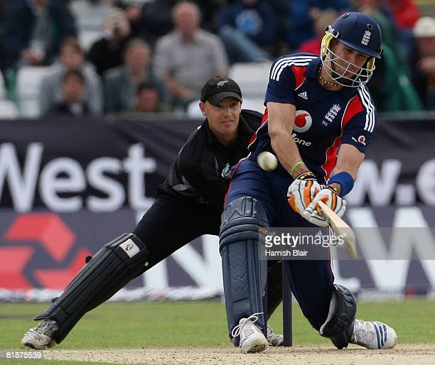 Kevin Pietersen of England reverse sweeps for six off the bowling of Scott Styris of New Zealand with Gareth Hopkins of New Zealand looking on during...