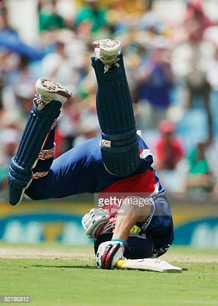 Kevin Pietersen of England rolls on the ground after colliding with Makhaya Ntini of South Africa to bring up his century during the seventh One Day...