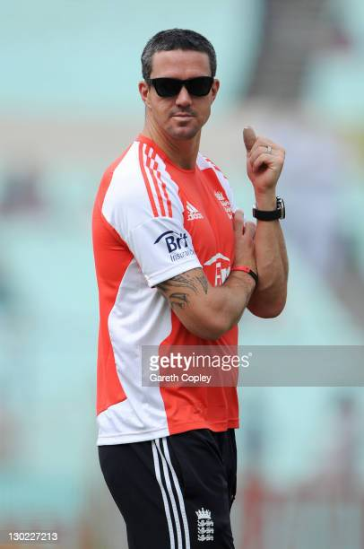Kevin Pietersen of England sits out the warm up with a fractured thumb before the 5th One Day International between India and England at Eden Gardens...