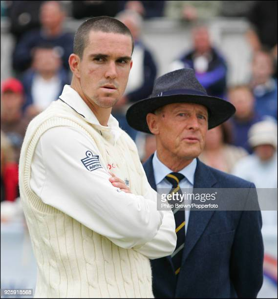 Kevin Pietersen of England stands with Geoffrey Boycott at the end of the the 4th Test match between England and West Indies at the Riverside Ground,...